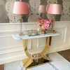 A console in a modern glamor style with a white marble top, ART DECO gold