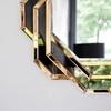 Spiegel in schwarzgoldenem geometrischem Rahmen DUNE GOLD BLACK OUTLET