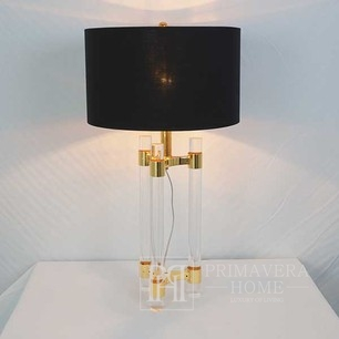A glamor table lamp with a transparent golden SERENA triangular base