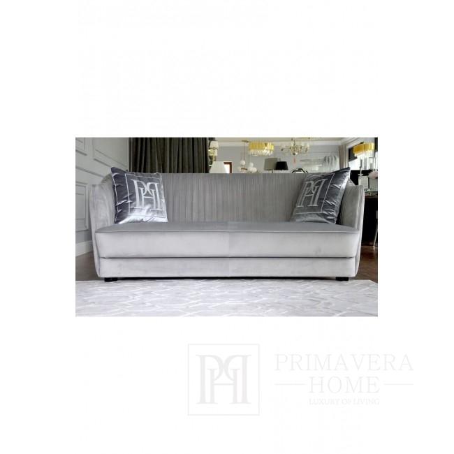 Elegantes New York Chic Plisseesofa in Grau