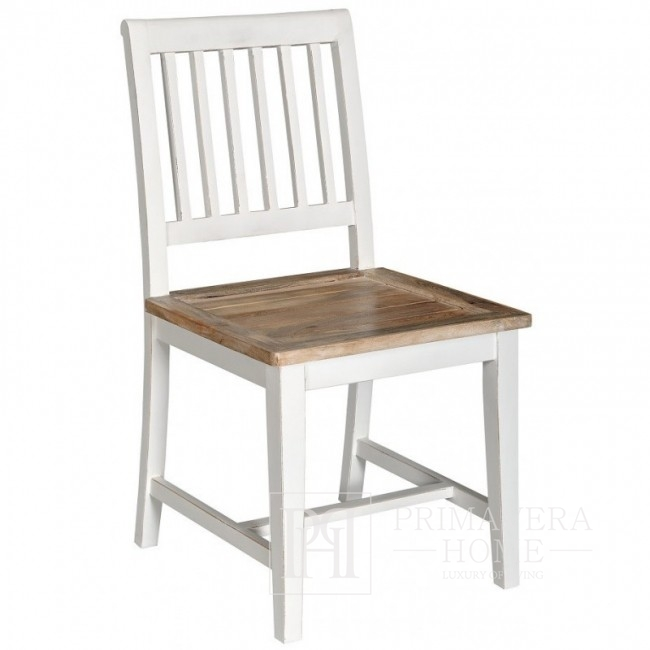 Bristol white chair in the back of the hamptons