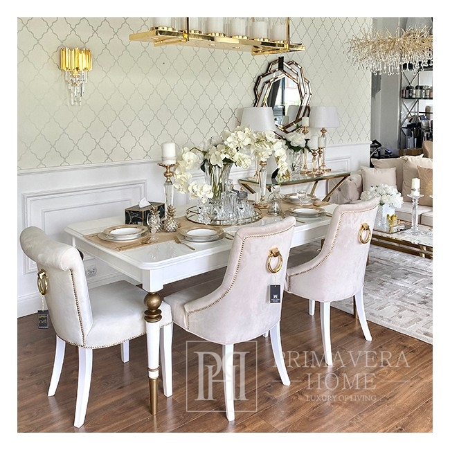 Modern, golden PRINCE glamor chair with a knocker for the dining room